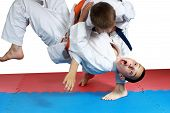 pic of judo  - Sportsman with a blue belt doing judo throw - JPG