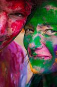 stock photo of holi  - European man and woman celebrate festival Holi in Delhi - JPG