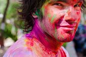 stock photo of holi  - European man celebrate festival Holi in Delhi - JPG