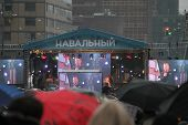 Leonid Parfenov speaks at a campaign rally opposition leader Alexei Navalny