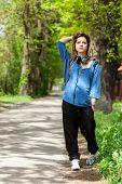 Teenage Girl Walking In Park