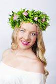 Portrait of a beautiful blonde with a wreath on his head