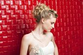 Attractive young bride with beautiful wedding hairstyle