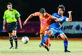 Sisaket Thailand-august 13: Sarayuth Chaikamdee Of Sisaket Fc. (orange) In Action During Thai Premie