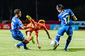 Sisaket Thailand-august 13: Nuttawut Khamrin Of Sisaket Fc. (orange) In Action During Thai Premier L