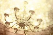 Chandelier hanging under a ceiling in home