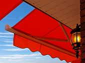 stock photo of awning  - Light under cafe awning - JPG