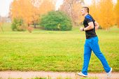 Male Athlete Jogging In The Morning In The Park
