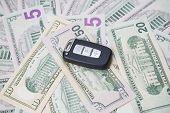 Car Key On A Background Of Dollars