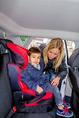 image of soliciting  - boy in a car seat - JPG