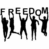 People Silhouettes Jumping And Holding The Letters With Word Freedom In Their Hands