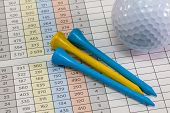 Golf Equipments Lying  On A Golf Score Card