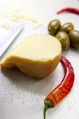 Food Composition Of Chili Pepper, Green Olives And Cheese.