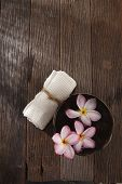 top view of frangipani flower ,hand towel and coconut shell