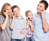 Mother, father, son and daughter talking at mobile phone. People with phone