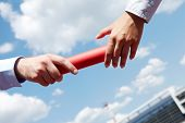 picture of relay  - Photo of business people hands passing baton during marathon - JPG