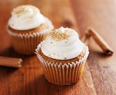 cinnamon chai cupcakes on wooden table top