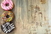 Bright Donuts On Wooden Background