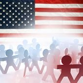 Team of people holding hands and American flag
