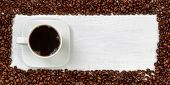 Fresh Dark Coffee Surrounded By Roasted Coffee Beans