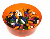 picture of laxatives  - Many colorful sugar candies in an orange bowl - JPG