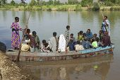 Passengers embark local ferry boat in Bahir Dar, Ethiopia.