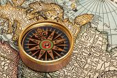 picture of longitude  - Old compass on vintage retro map - JPG