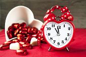 Valentine Love Heart Shaped Red Love Clock With Sweet Chocolates.