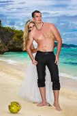 Bride And Groom Have A Fun On A Tropical Beach