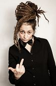 stock photo of middle finger  - Girl with middle finger up in the studio - JPG