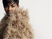 Woman In A Faux Fur Looking At Camera