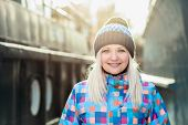 Smiling naughty blonde woman winter outdoors