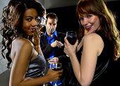 pic of bff  - women seducing a man at a bar or nightclub - JPG