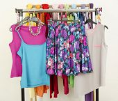 Cute Summer Outfits Displayed On A Rack.