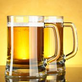 Beer mugs with froth close up