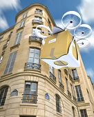 3D rendering of a commercial drone carrying a box flying around Paris