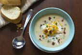 stock photo of scallion  - Creamy loaded baked potato soup with scallion garnished and fresh Italian bread