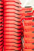 Many Red Plastic Baskets In Supermarket