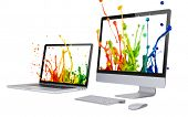 Laptop and computer display isolated on white background.