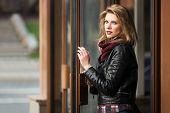 foto of jacket  - Young fashion blond woman in leather jacket at the mall door - JPG