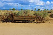 picture of wagon  - Historic wooden wagon next to sagebrush taken in the Great Basin Desert - JPG
