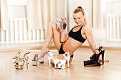 image of pole dance  - Young Slim Pole Dance Blond Woman smile - JPG