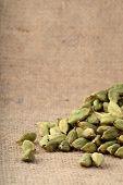 stock photo of cardamom  - close up of Green Cardamom pods on sack cloth - JPG