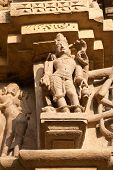 stock photo of kamasutra  - Stone carved erotic sculptures on on JainTemples - JPG