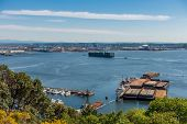 stock photo of barge  - A container ship enters the Port of Tacoma - JPG