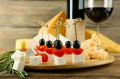 pic of canapes  - Cheese canapes with wine on table close up - JPG