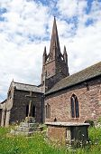 picture of church-of-england  - St Peter and St Paul church with a stone cross in the foreground Weobley Herefordshire England UK Western Europe. ** Note: Visible grain at 100%, best at smaller sizes - JPG
