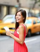 stock photo of cabs  - Woman in New York City using Tablet computer - JPG
