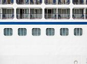 foto of cruise ship caribbean  - Windows verandas and decks on the side of a massive luxury cruise ship - JPG