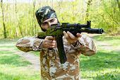 image of rifle  - Bearded soldier with a rifle in the woods - JPG